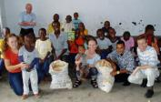Genevieve, Lenka & Wolfg. bringing bread, stories, games and joy to the orphans.