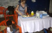We prepare a special meal for the orphans: Lenka & Anissa.