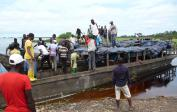 The maize is shipped on 3 different rivers to Kinshasa - Locally fabricated boats for people & goods