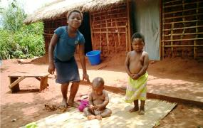 Kids in front of a typical house