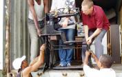 19. 2004: Congo – our third container of humanitarian aid for Africa: unloading a shoe sewing machine