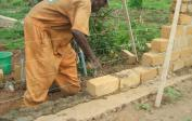 29. Carefully building walls with cement mortar