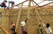 31. Workers raising the roof beams